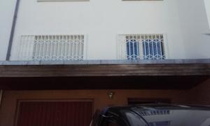 Scherengitter angebaut Garagen Vordach